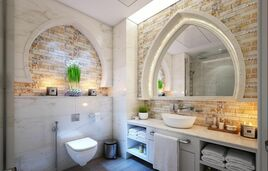 High end modern bathroom with beautiful stone finishes on two walls